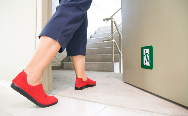 Foot heading to Emergency exit stairs