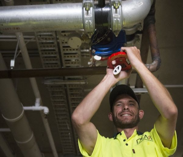 Dem - A man installing fire protection