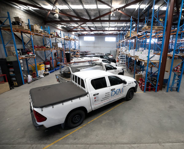 Company cars of DEM Fire inside a warehouse