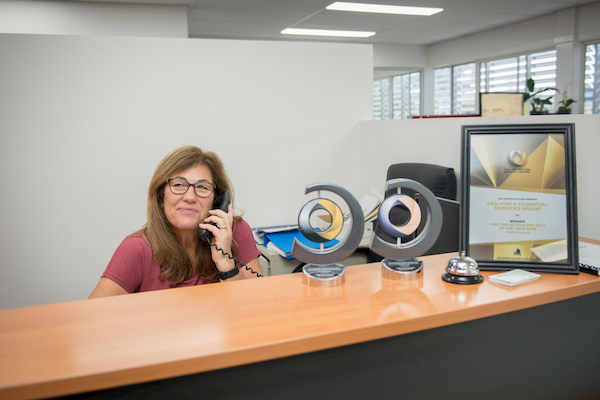 Woman on the front desk using telephone