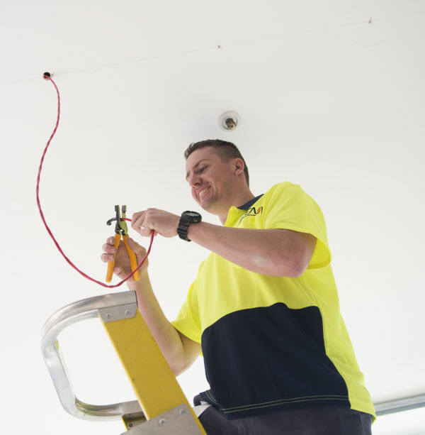 Man fixing the electric wire
