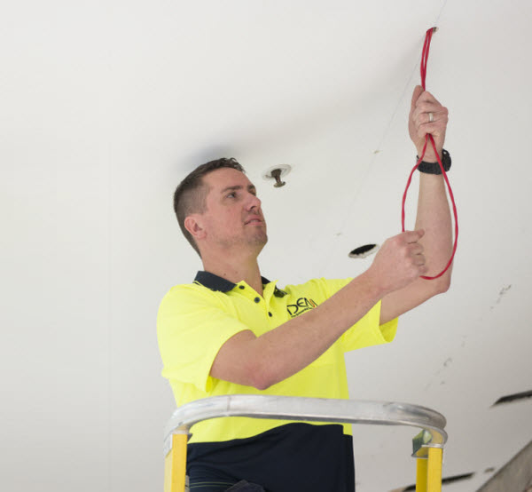 A man fixing electric wires