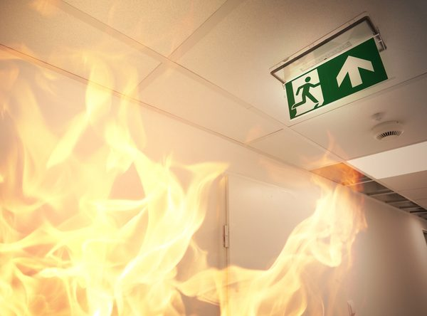 Fire inside a building with Fire exit and fire alarm