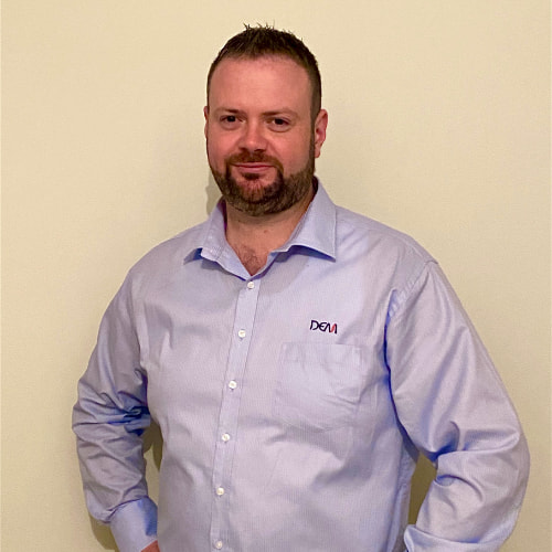 Man wearing a corporate uniform