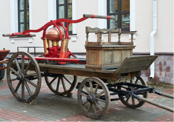 Wooden retro fire truck with a hand pump