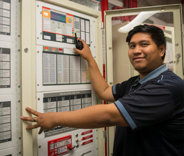 Man checking a machine controller