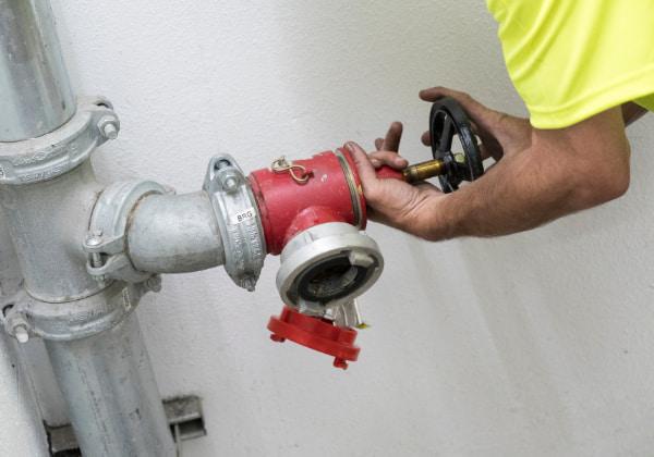 Man installing a fire sprinkler