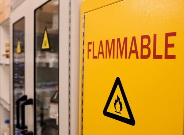 Close up black flammable sign with red letter