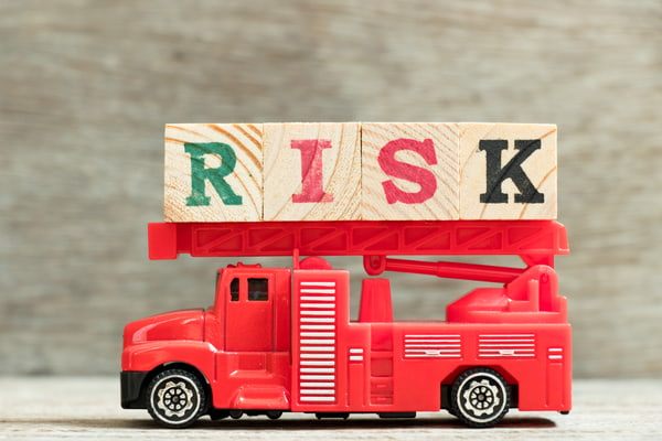 Red fire truck with block word risk