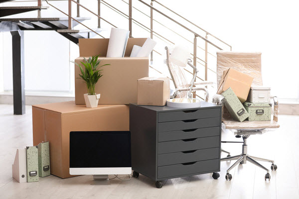New moved in boxes and office furniture inside a new building